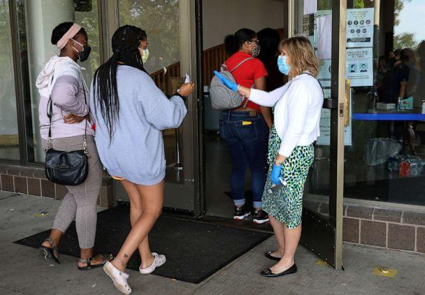 PHOTO: Unemployed Kentucky residents enter the Kentucky Career Center for help with their unemployment claims as hundred more wait in long lines outside on June 19, 2020 in Frankfort, Kentucky. (John Sommers II/Getty Images)