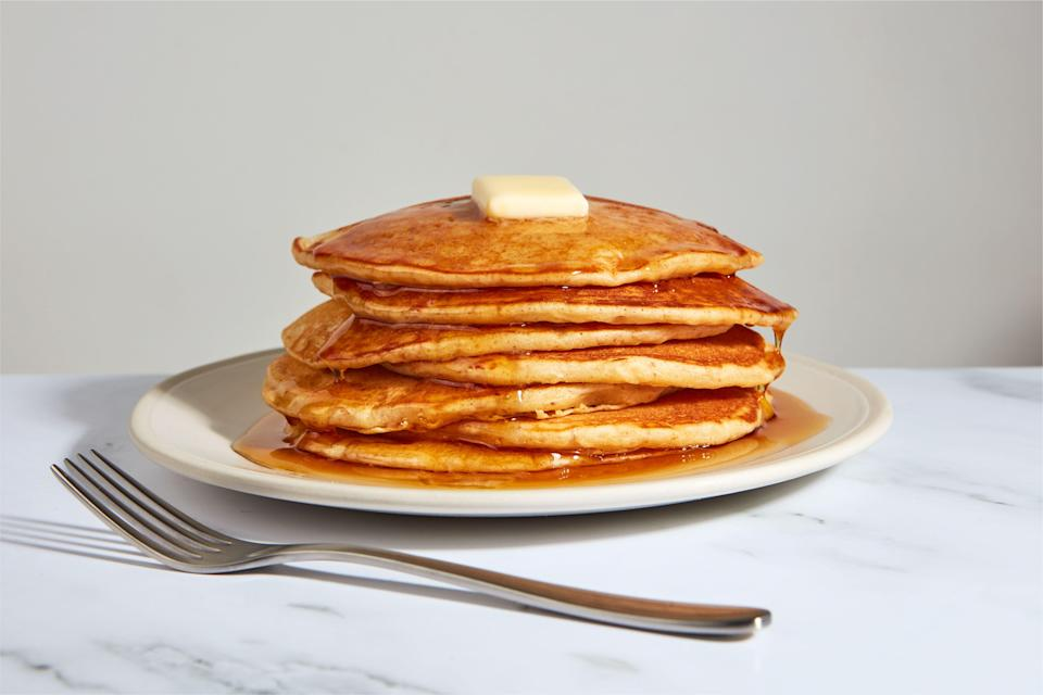 """With this shelf-stable homemade pancake mix ready to go in your pantry, you're always minutes away from an exceptional pancake breakfast (or breakfast for dinner, live your life). The key is a combo of two powdered dairy products: <a href=""""https://www.amazon.com/Cultured-Buttermilk-Cooking-Baking-Powdered/dp/B084QD114V/"""" rel=""""nofollow noopener"""" target=""""_blank"""" data-ylk=""""slk:buttermilk"""" class=""""link rapid-noclick-resp"""">buttermilk</a>, for that perfect tang, and <a href=""""https://www.amazon.com/Hoosier-Hill-Farm-Butter-powder/dp/B00DC5ZKQE/"""" rel=""""nofollow noopener"""" target=""""_blank"""" data-ylk=""""slk:butter"""" class=""""link rapid-noclick-resp"""">butter</a>, which you'll brown in a saucepan with half the powdered buttermilk for a touch of nuttiness. Just add eggs and—surprise!—seltzer water, which provides extra lift and fluffiness. The recipe below yields enough base for two batches of 18 pancakes each; keep the extra powdered base in an airtight container as a gift to future you. <a href=""""https://www.epicurious.com/recipes/food/views/homemade-pancake-mix-brown-butter-buttermilk?mbid=synd_yahoo_rss"""" rel=""""nofollow noopener"""" target=""""_blank"""" data-ylk=""""slk:See recipe."""" class=""""link rapid-noclick-resp"""">See recipe.</a>"""