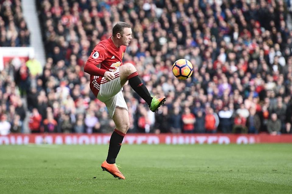 Manchester United captain Wayne Rooney, left out of the England squad for the forthcoming matches against Germany and Lithuania, has declared himself fit after a knee injury (AFP Photo/Oli SCARFF )