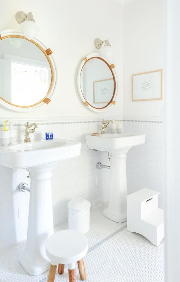 """<p>Here, a chic bathroom is subtly made to look nautical with the addition of stylish mirrors. And with two sinks—and two step stools—it's perfect for siblings to share.</p><p><strong>See more at <a href=""""https://www.monikahibbs.com/a-nautical-boys-room/"""" target=""""_blank"""">Monika Hibbs</a>.</strong></p><p><a class=""""body-btn-link"""" href=""""https://www.amazon.com/Kings-Brand-Finish-Bedroom-Storage/dp/B00CYNI2XI/?tag=syn-yahoo-20&ascsubtag=%5Bartid%7C10050.g.31135713%5Bsrc%7Cyahoo-us"""" target=""""_blank"""">SHOP STEP STOOLS</a></p>"""