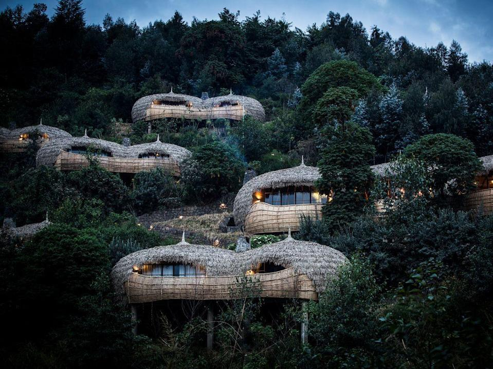 """<p>""""Staying at <a href=""""https://wilderness-safaris.com/our-camps/camps/bisate-lodge"""" rel=""""nofollow noopener"""" target=""""_blank"""" data-ylk=""""slk:Bisate Lodge"""" class=""""link rapid-noclick-resp"""">Bisate Lodge</a>, you could be forgiven for thinking you were being treated like royalty,"""" says Reco trip designer Sunit Sanghrajka. """"This may well be the case, as this lodge—in the epicenter of mountain gorilla country—was inspired by the Rwandan Royal Palace. By employing local artisans to construct much of the lodge, vanishing skills have been retained within the community for at least another generation. The woven surfaces and rich textures tempt the fingertips as much as the eyes.""""</p><p>If that's not enough of a recommendation for you, this luxe wilderness camp, adjacent to Volcanoes National Parks, offers countless adventures while allowing you to return to well-appointed suites to rest up for the next thrill. </p>"""