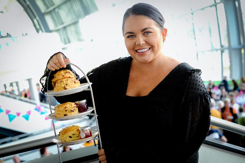 GATESHEAD, ENGLAND - OCTOBER 23: TV personality, Scarlett Moffatt, hosted a Guinness World Records TM attempt for the Largest Cream Tea Party, in celebration of The National Lottery's 25th Birthday and its impact on bringing people together, on October 23, 2019 in Gateshead, England. Scarlett was joined by community heroes from across the UK at Sage Gateshead. (Photo by Thomas Jackson/Getty Images for National Lottery)
