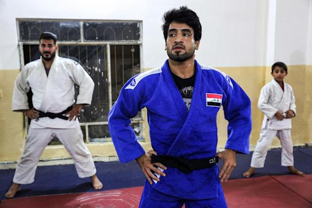 Iraqi judoka Ahmad Daoud (centre) trains with other athletes at a gym in Baghdad against a backcloth of disputes between the Iraqi Olympic Committee and the country's Ministry of Youth and Sports. (AFP Photo/AHMAD AL-RUBAYE)