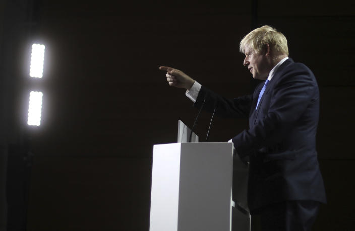 Britain's Prime Minister Boris Johnson gestures as he speaks during a press conference on the third and final day of the G-7 summit in Biarritz, France Monday, Aug. 26, 2019. (AP Photo/Markus Schreiber)