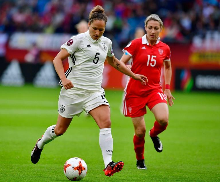 Germany's defender Babett Peter (L) scored during the women's Euro game against Denmark, setting her team up for a 2-0 victory and a spot in the quarter-finals