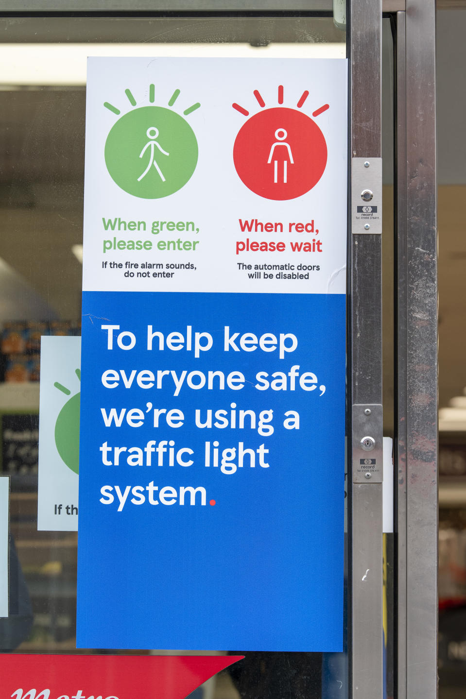 LONDON, UNITED KINGDOM - 2020/10/12: Signage seen at the Tesco metro supermarket in Dean Street, which has a traffic light system to let shoppers know when it is safe to enter the store so it can adhere to social distancing restrictions. (Photo by Dave Rushen/SOPA Images/LightRocket via Getty Images)