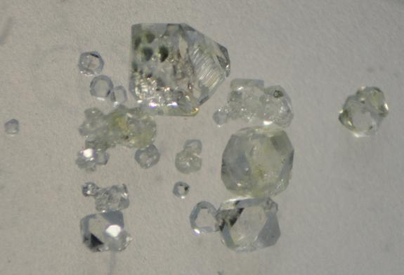 Synthetic crystals of the calcium phosphate mineral whitlockite similar to those used to produce the extraterrestrial mineral merrillite. If life ever arose on Mars, merrillite may have been a major source of biologically required phosphate. La