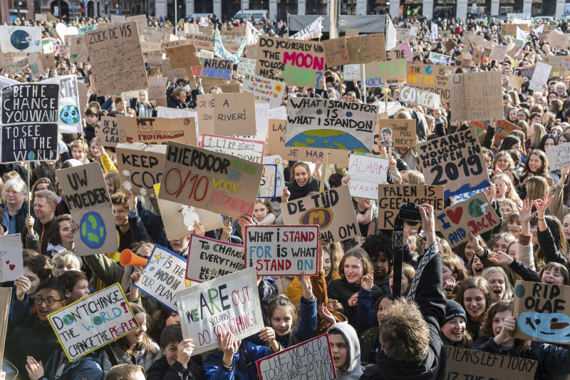 People march during a climate change protest in Leuven, Belgium, Thursday, Feb. 7, 2019. A Belgian Environment Minister has been forced to resign after saying she had state security confirmation that massive climate demonstrations in recent weeks were staged as a plot against her. (AP Photo/Geert Vanden Wijngaert)