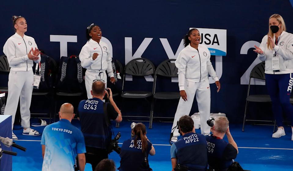 Athletes from the USA support their teammate Simon Biles during the Artistic Gymnastics Women Final of the Tokyo 2020 Olympic Games at the Ariake? Gymnastics Centre in Tokyo, Japan, 27 July 2021 (EPA)