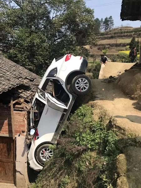 Chinese driver hits the roof after losing control of his car