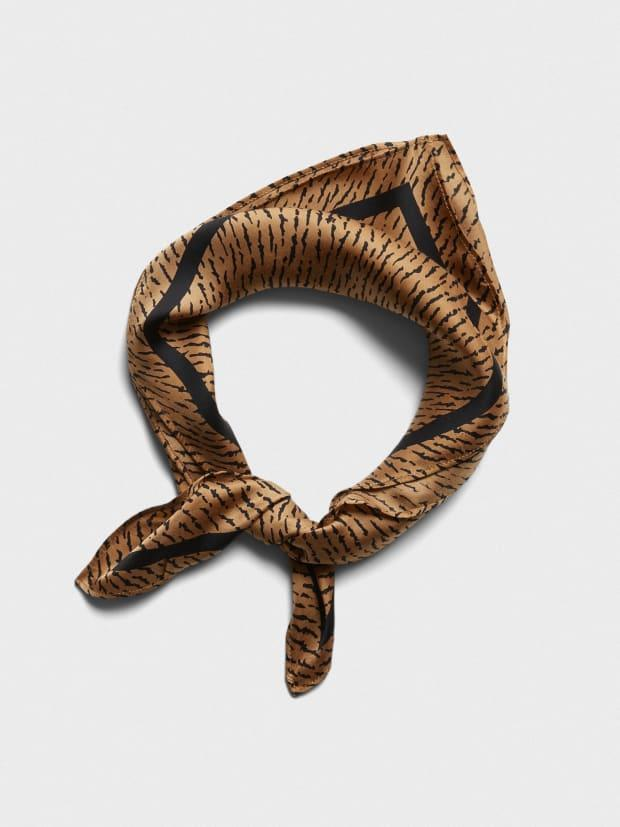 "<p>Banana Republic Tiger Square Scarf, $25, <a href=""https://rstyle.me/+PDsxXsU6UurLZ9qpZNqjww"" rel=""nofollow noopener"" target=""_blank"" data-ylk=""slk:available here"" class=""link rapid-noclick-resp"">available here</a>.</p>"
