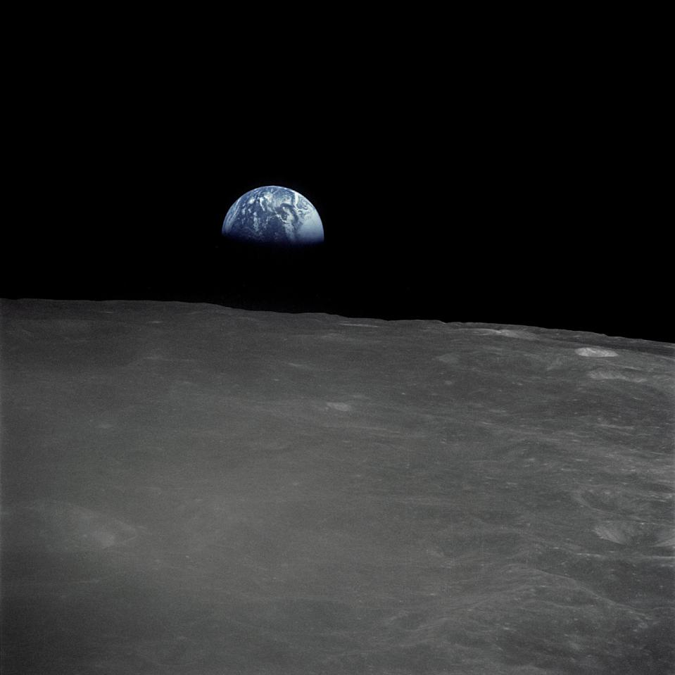 "This stunning view of Earth rising above the lunar horizon was captured by NASA's Apollo 16 crew shortly before they landed on the moon 48 years ago. The astronauts snapped this picture, which appears to have been inspired by Apollo 13's famous ""Earthrise"" photo, on April 20, 1972, the same day the lunar module Orion touched down on the surface with NASA astronauts John Young, Apollo 16 commander, and lunar module pilot Charlie Duke. Command module pilot Ken Mattingly stayed in orbit during their 71-hour stay on on the surface."
