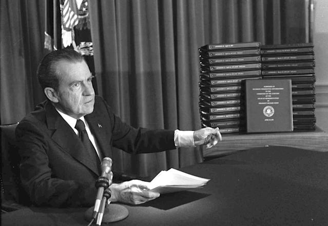 <p>President Richard M. Nixon points to the transcripts of the White House tapes in Washington, D.C. on April 29, 1974, after he announced on television that he would turn over the transcripts to House impeachment investigators. (Photo: AP) </p>