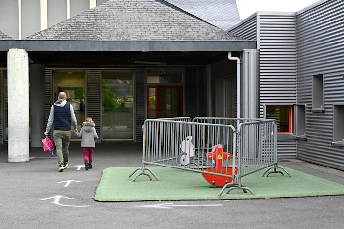 Play equipment is cordoned off at a school in Bruz, France, on May 12. (Photo: DAMIEN MEYER via Getty Images)