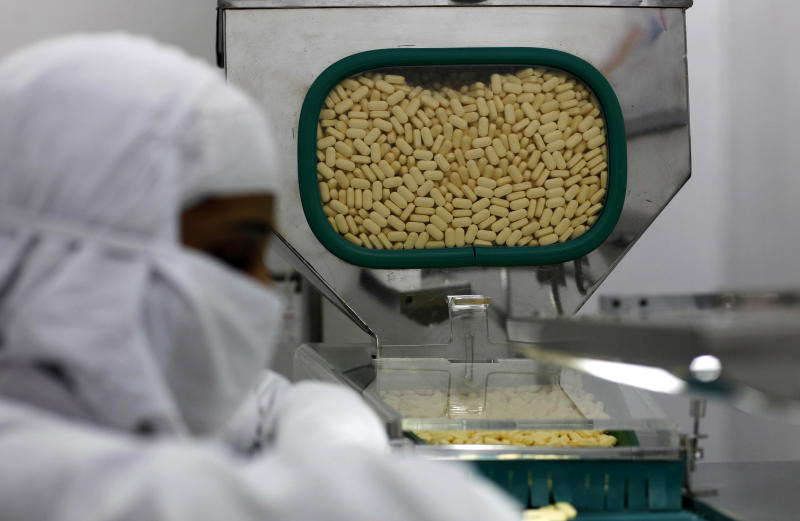 FILE - In this Thursday, Feb. 9, 2012 file photo, a pharmacist works in a lab where medicines are being produced at a Cipla manufacturing unit on the outskirts of Mumbai, India. A lawyer for healthcare activists says India's Supreme Court has rejected drug maker Novartis AG' right to patent a new version of a lifesaving cancer drug. The landmark ruling today is a victory for India's (Canadian) $26 billion generic drug industry that provides cheap medicines to millions around the world. Novartis has fought a legal battle in India since 2006 for a fresh patent for its cancer drug Glivec. Cipla makes a generic version of Glivec. (AP Photo/Rafiq Maqbool, File)