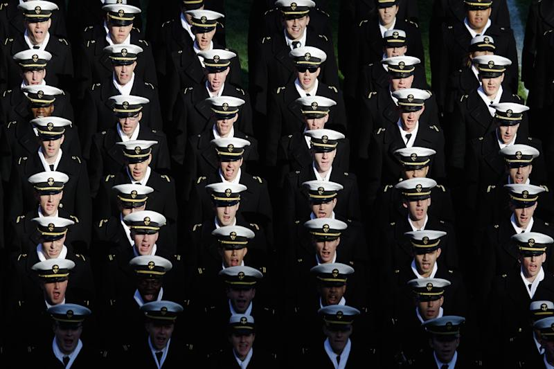 LANDOVER, MD - DECEMBER 10: Navy Midshipmen march off the field following pre-game ceremonies before the start of the112th annual Army-Navy Game at FedEx Field on December 10, 2011 in Landover, Maryland.  (Photo by Rob Carr/Getty Images)