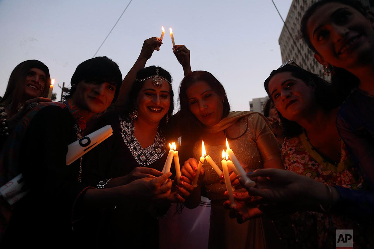 <p>Members of the Pakistani transgender community light candles during a symbolic catwalk in Karachi, Pakistan. The event was held to highlight the continuous violence and humiliation against transgender people. (AP Photo/Shakil Adil) </p>