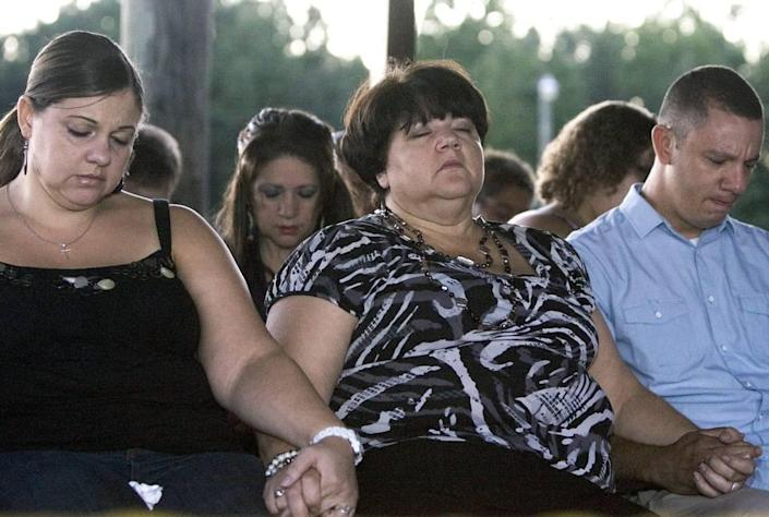 From left, Faith's sister Rolanda Hedgepeth, mother Connie Hedgepeth and cousin Jonathan Hedgepeth join other family, friends and community members at a candlelight vigil at the Haliwa-Saponi Tribal School in Hollister to remember and pray for Faith Hedgepeth. A member of the Haliwa-Saponi American Indian Tribe, Hedgepeth was found dead in her Chapel Hill apartment on Friday. She was a sophomore, Biology major at UNC-Chapel Hill.