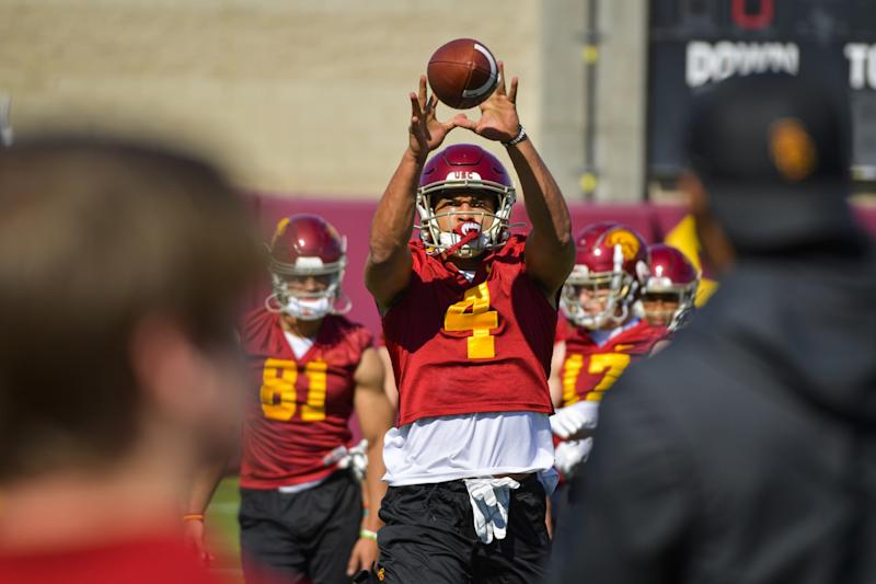 USC wide receiver Bru McCoy catches a pass during a team practice session.