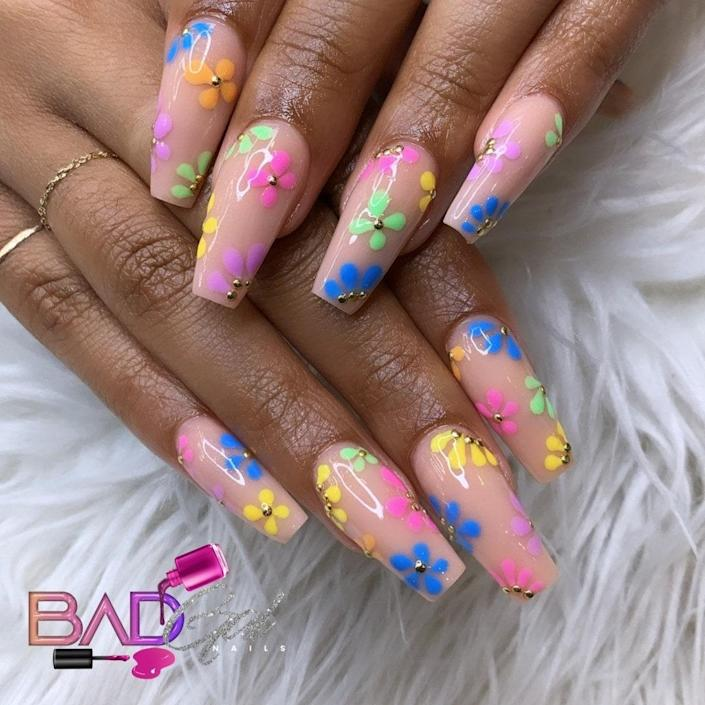 Add color to nude sets with cute florals, such as the ones Lewis painted here. We love the color palette of yellow, blue, pink, lavender, and seafoam that she chose. Teeny, gold, 3D decals form the pistils smack dab in the center, bringing life to each bloom.