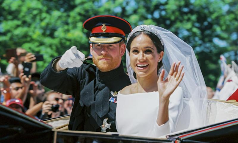 Prince Harry and Meghan Markle during the procession after getting married in Windsor, England.