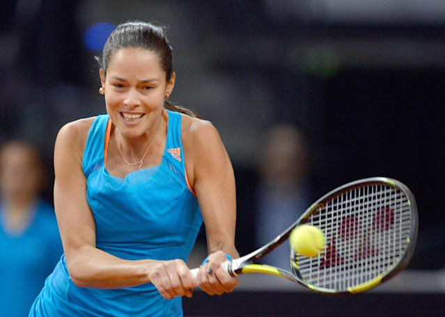 Serbia's Ana Ivanovic returns the ball to Russia's Maria Sharapova during their final match at the Porsche tennis Grand Prix in Stuttgart, Germany, Sunday, April 27, 2014. (AP Photo/dpa, Bernd Weissbrod)