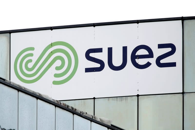 FILE PHOTO: The logo of Suez is seen on the top of a building in Rueil-Malmaison