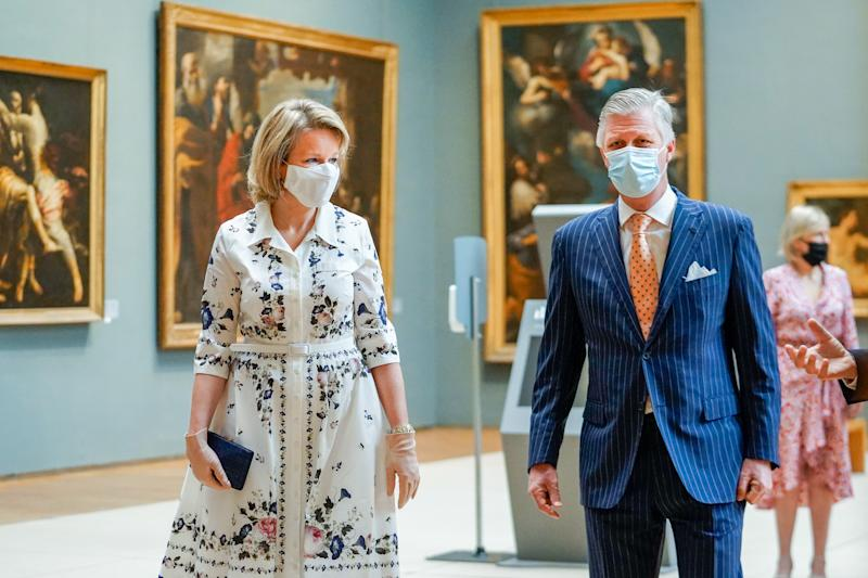 "BRUSSELS, BELGIUM - MAY 19: King Philippe of Belgium and Queen Mathilde of Belgium wearing Face Masks visit the Royal Museums of Fine Arts on May 19, 2020 in Brussels, Belgium. The Old Masters Museum covers a period from the 15th to the 18th century and opens its doors again after a 2-monthly period of closure due to the outbreak of COVID-19. With this visit the King and the Queen give their support to the severely affected cultural sector. The Belgian government asks all citizens to stay home and refrain from ""non-essential inbound and outbound travel"" to slow the spread of the coronavirus. 9,108 people have died in Belgium from COVID-19. (Photo by Daïna Le Lardic /Royal Belgium Pool/Getty Images)"