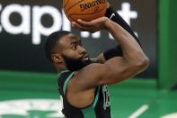 Boston Celtics' Jaylen Brown shoots during the second half of an NBA basketball game against the Cleveland Cavaliers, Sunday, Jan. 24, 2021, in Boston. (AP Photo/Michael Dwyer)