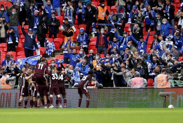 Leicester players and fans celebrate Youri Tielemans' strike