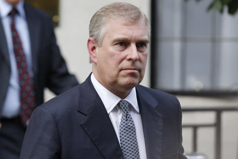 FILE- In this Wednesday, June 6, 2012 file photo, Britain's Prince Andrew leaves King Edward VII hospital in London after visiting his father Prince Philip . Two days after an intruder was discovered prowling around Buckingham Palace, police confronted Prince Andrew, the second son of Queen Elizabeth II, in the royal residence's garden and demanded he identify himself. The embarrassing mix-up occurred on Wednesday, Sept. 4, 2013, following an even more embarrassing security breach Monday, when a suspected burglar was arrested after having scaled the fence around the palace. (AP Photo/Sang Tan, File)