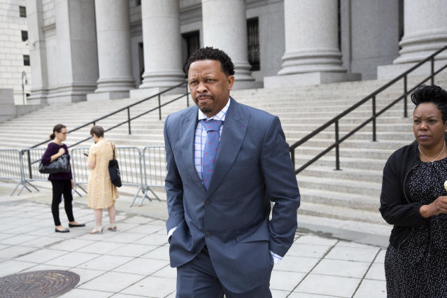 Former Oklahoma State assistant basketball coach Lamont Evans leaves after his sentencing in Federal Court June 7, 2019, in New York. Evans is one of four convicted in a scheme to pay coaches and families of top-tier players to choose favored managers and financial advisors. (AP Photo/Kevin Hagen)