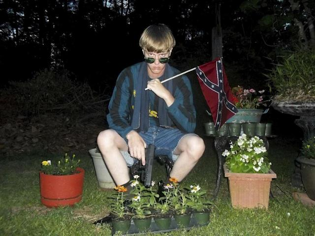 This undated photo that appeared on Lastrhodesian.com, a website investigated by the FBI in connection with Dylann Roof, shows him posing for a photo holding a Confederate flag. (Photo: Lastrhodesian.com via AP)