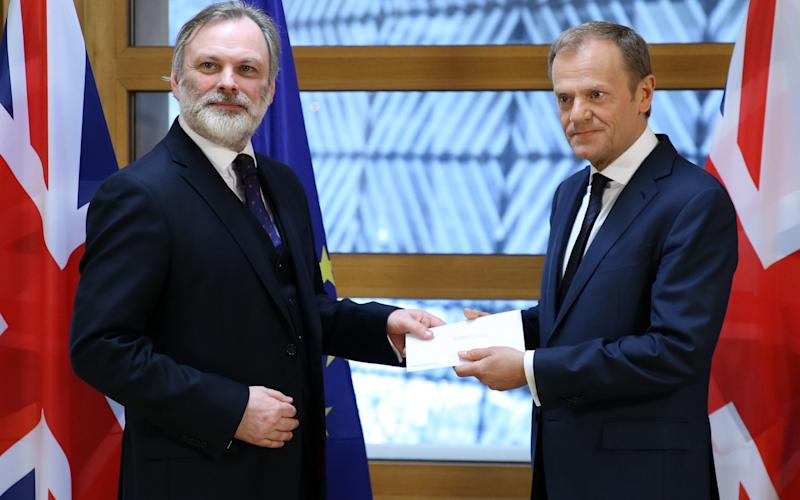 British Ambassador to the EU Tim Barrow hands the Brexit letter to European Council President Donald Tusk in Brussels - Credit: Xinhua / Barcroft Images/Xinhua / Barcroft Images