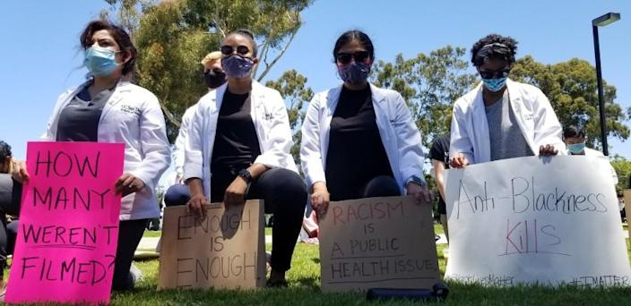 Scores of UC San Diego medical students and others rallied on the La Jolla campus Monday to speak out against racism.