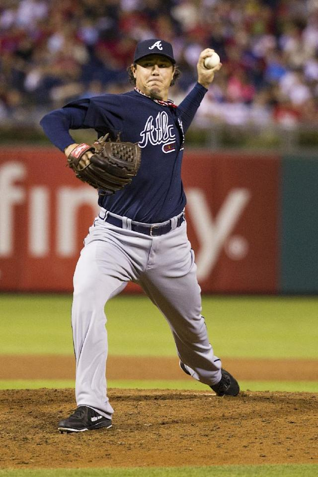 Atlanta Braves relief pitcher Scott Downs pitches during the sixth inning of a baseball game against the Philadelphia Phillies, Saturday, Sept. 7, 2013, in Philadelphia. The Phillies win 6-5. (AP Photo/Chris Szagola)