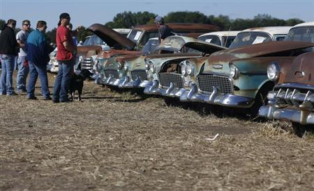 Potential buyers and car enthusiasts check out 1950s era Chevrolet sedans, part of the vintage automobiles from the Lambrecht Collection put up for auction in Pierce, Nebraska, September 28, 2013. REUTERS/Jim Urquhart