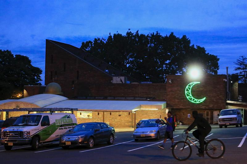 People walk by the Islamic Center of Passaic County in Paterson, New Jersey, which has the second-largest Muslim community in the U.S., after Dearborn, Michigan, according to Omar Awad, president and CEO of ICPC. (Eduardo Munoz / Reuters)