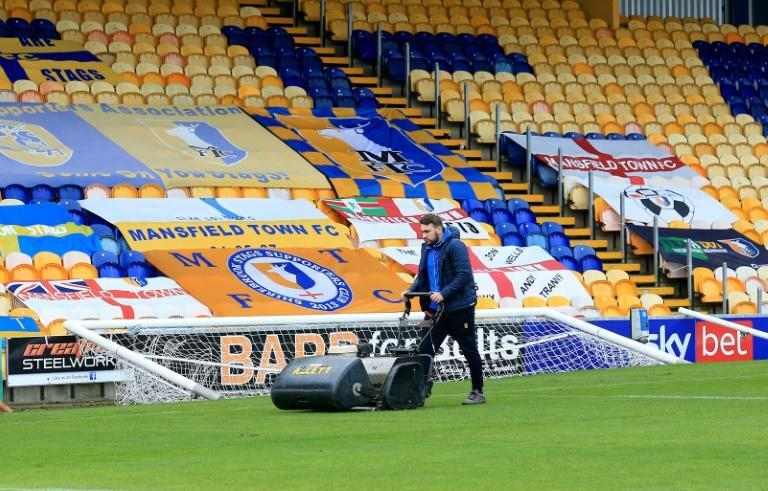 Groundstaff work at Mansfield Town's Field Mill stadium