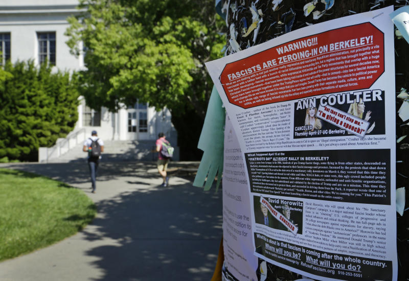 """A leaflet is seen stapled to a message board near Sproul Hall on the University of California at Berkeley on Friday, April 21, 2017, in Berkeley, Calif. The campus is bracing for a showdown next week, when the conservative provocateur Ann Coulter has vowed to speak in defiance of the university's wishes. Officials, police and the campus Republicans who invited Coulter, say there are valid concerns for violence in what is being called an ongoing """"Battle of Berkeley."""" (AP Photo/Ben Margot)"""