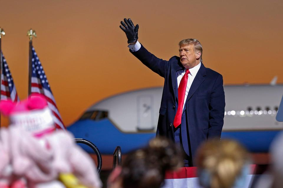 President Donald Trump waves farewell to the crowd at a campaign rally Friday, Oct. 30, 2020 in Rochester, Minn.