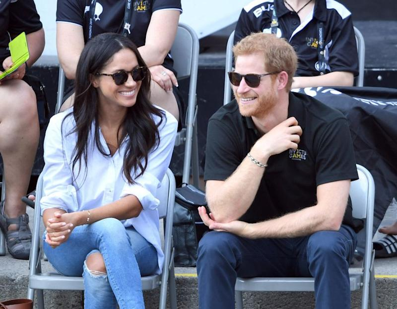 Meghan Markle's taking heat for not wearing a more demure outfit for her first public engagement with Prince Harry. Source: Getty