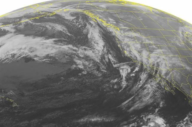 This NOAA satellite image taken Dec. 16, 2014 shows front moving into the West Coast (AP/NOAA)