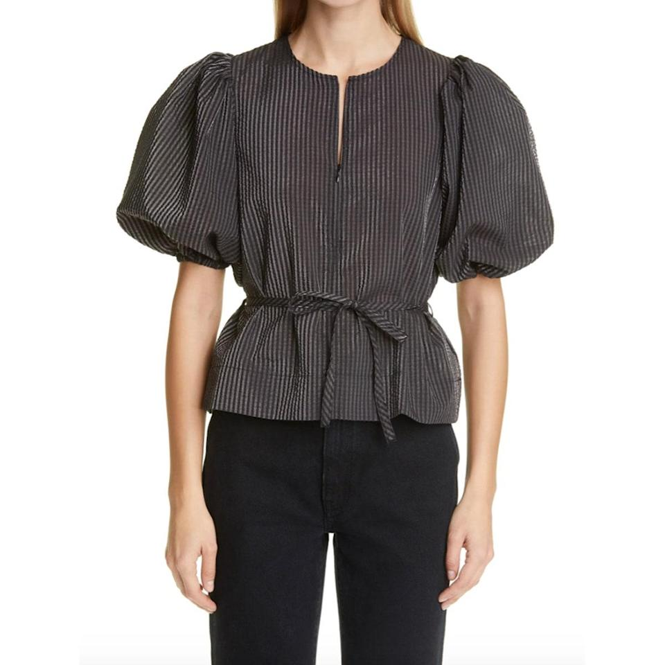 """With Zoom meetings and FaceTime calls a now daily occurrence, we've taken a shine to puff-sleeve tops as an easy way to look and feel put together. Grab this cutie to wear with your <a href=""""https://www.glamour.com/gallery/best-sweatpants-for-women?mbid=synd_yahoo_rss"""" rel=""""nofollow noopener"""" target=""""_blank"""" data-ylk=""""slk:favorite sweatpants"""" class=""""link rapid-noclick-resp"""">favorite sweatpants</a>. $185, Nordstrom. <a href=""""https://www.nordstrom.com/s/ganni-balloon-sleeve-gingham-seersucker-top/5696570"""" rel=""""nofollow noopener"""" target=""""_blank"""" data-ylk=""""slk:Get it now!"""" class=""""link rapid-noclick-resp"""">Get it now!</a>"""
