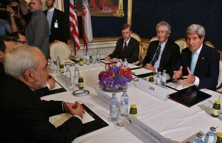 Iran's Foreign Minister Mohammad Javad Zarif meets with U.S. Secretary of State John Kerry at talks between the foreign ministers of the six powers negotiating with Tehran on its nuclear program in Vienna