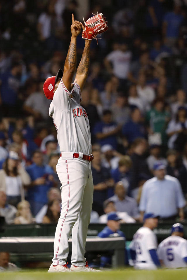 Cincinnati Reds relief pitcher Raisel Iglesias celebrates the team's 3-2 win over the Chicago Cubs in 10 innings in a baseball game Wednesday, Sept. 18, 2019, in Chicago. (AP Photo/Charles Rex Arbogast)