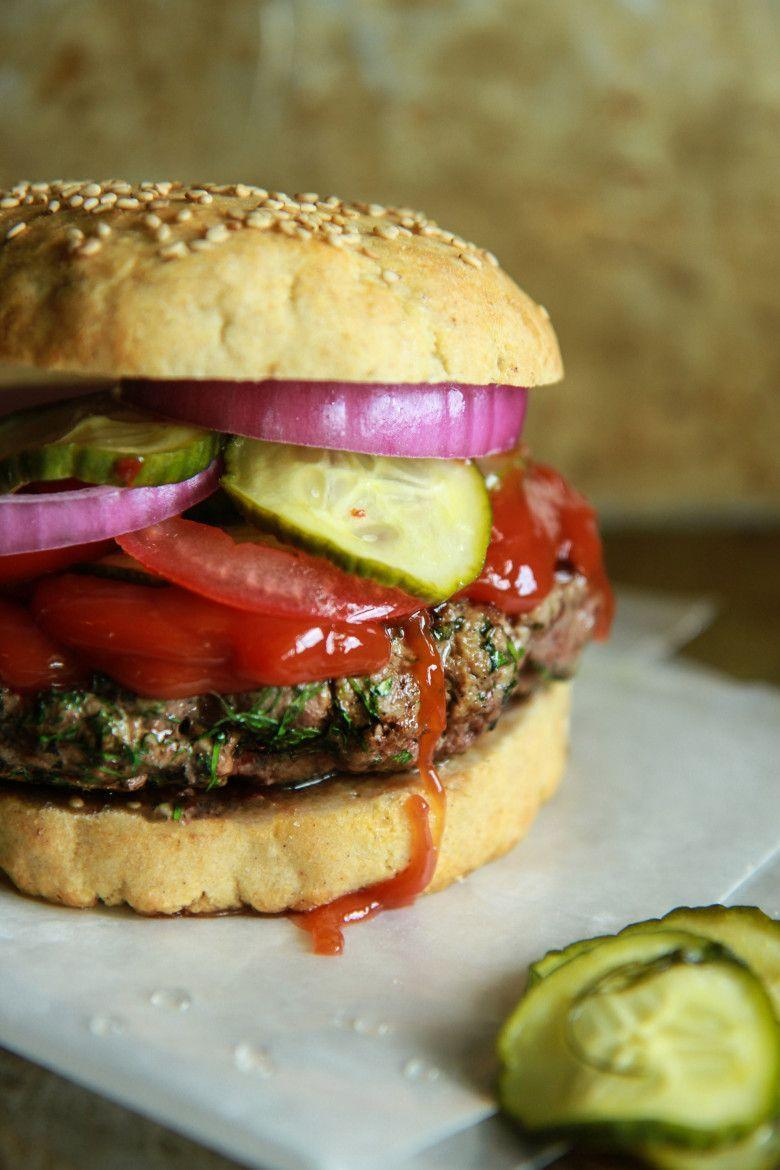 """<p>Fresh minced mint, flat leaf parsley, dill, and garlic add intense flavor to this gorgeous burger. Don't forget the quick-pickled cucumbers and a delicious semi-homemade ketchup.<strong><br></strong></p><p><strong><a href=""""https://thepioneerwoman.com/food-and-friends/5-epic-burgers-with-grilling-tips/"""" rel=""""nofollow noopener"""" target=""""_blank"""" data-ylk=""""slk:Get the recipe"""" class=""""link rapid-noclick-resp"""">Get the recipe</a>.</strong></p><p><a class=""""link rapid-noclick-resp"""" href=""""https://go.redirectingat.com?id=74968X1596630&url=https%3A%2F%2Fwww.walmart.com%2Fip%2FThe-Pioneer-Woman-Timeless-Beauty-Pre-Seasoned-Plus-12-Cast-Iron-Fry-Pan%2F106289810&sref=https%3A%2F%2Fwww.thepioneerwoman.com%2Ffood-cooking%2Fmeals-menus%2Fg32188535%2Fbest-grilling-recipes%2F"""" rel=""""nofollow noopener"""" target=""""_blank"""" data-ylk=""""slk:SHOP CAST-IRON PANS"""">SHOP CAST-IRON PANS</a></p>"""