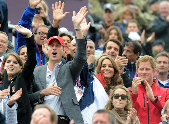 Britain's Prince William, from left, and wife Kate, the Duke and Duchess of Cambridge, and Prince Harry, right, cheer as Britain's equestrian eventing team arrives to collect their medals during the individual eventing jumping final at the 2012 Summer Olympics, Tuesday, July 31, 2012, at Greenwich Park in London. (AP Photo/Owen Humphreys, PA) UNITED KINGDOM OUT; NO SALES; NO ARCHIVE