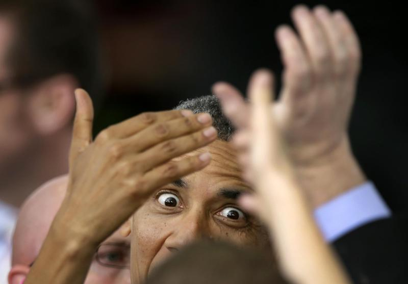 President Barack Obama greets supporters after speaking at a campaign stop at The Mississippi Valley Fairgrounds, Wednesday, Oct. 24, 2012, in Davenport, Iowa. The President is on a two day campaign trip across six battleground states. (AP Photo/Charlie Neibergall)