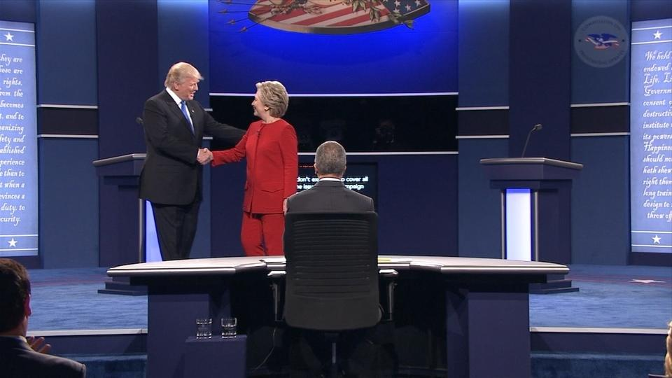 Republican presidential nominee Donald Trump and Democratic nominee Hillary Clinton start off with a handshake as the two prepare to duel in the first of three presidential debates. Rough Cut (no reporter narration).